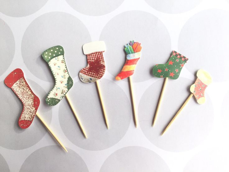 A personal favourite from my Etsy shop https://www.etsy.com/uk/listing/535069806/christmas-cupcake-topper-stocking