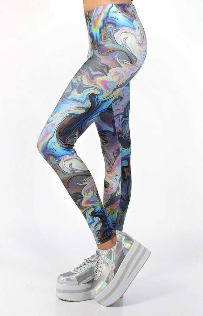 One Size Fits All! Oil Slick Leggings, Made from a stretch material in a hypnotizing oil slick print.  $75.00