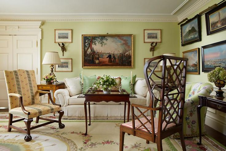 A Stately Living Room in Boston, Massachusetts. This view reveals how the green color of the wall and silk pillows resonate with the green in the Aubusson rug. Image Courtesy Scott Snyder.