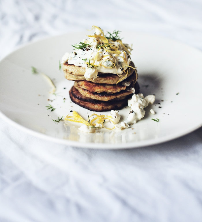 Potato pancakes with feta, dill and lemon toppings.