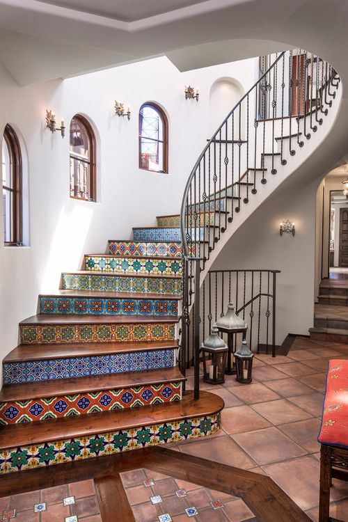 'Spanish-coastal' style, Los Angeles, Norman Design Group. ~ Just love the painted stair risers, winding wrought iron railing accompanied by palladium-style windows. ~