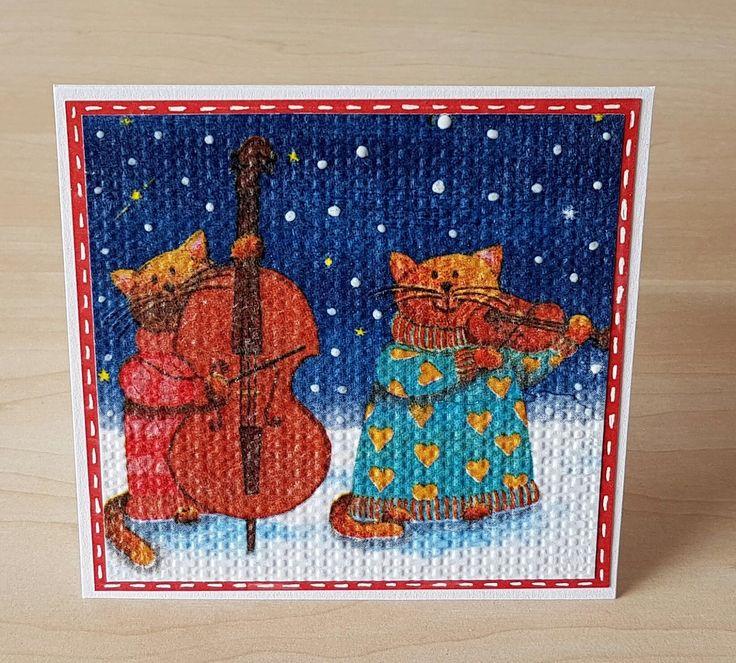 Musikalische Katzen in Schneelandschaft