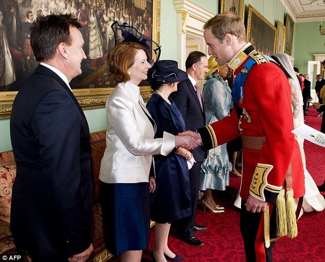 Prince William greets Australia's Prime Minister Julia Gillard and her partner Tim Mathieson at Buckingham Palace in London after his wedding to Catherine