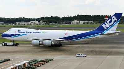 Nippon Cargo Airlines-NCA (JP)  Boeing 747-400F JA05KZ aircraft, named ''NCA Apollo'', with the sticker ''30 years anniversary from the first flight'' on the airframe, towing to the spot for cargo loading at Japan Tokyo Narita International Airport. 15/09/2015. (Apollo=one of the most important & complex of the Olympian deities in classical Greek & Roman mythology).