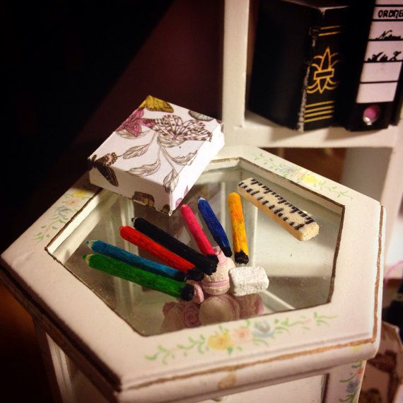 DOLLHOUSE STATIONARY SET - 1:12 scale handmade stationary set including 7 pencil crayons, a ruler and an eraser.