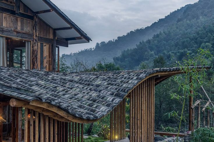 Springingstream guesthouse's wavy tiled roof is based on the outline of surrounding mountains