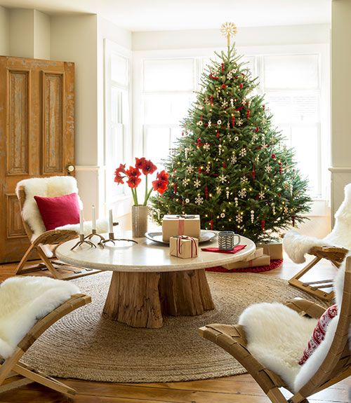 Cose Nuove imports the Finnish birch and felt ornaments that trim the tree in…