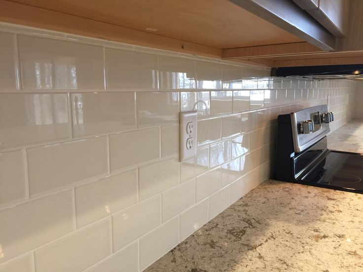Kitchen Backsplash In A 3x6 Almond Subway Tile With