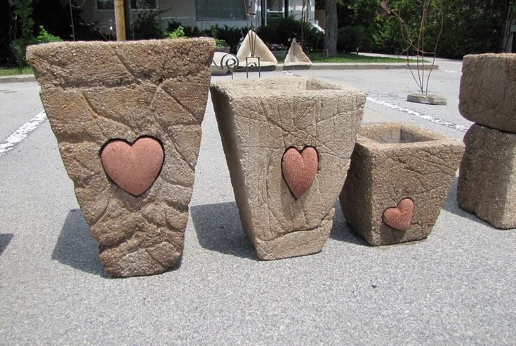 Great Way to use all those heart rocks I find...put into a hypertufa pot!