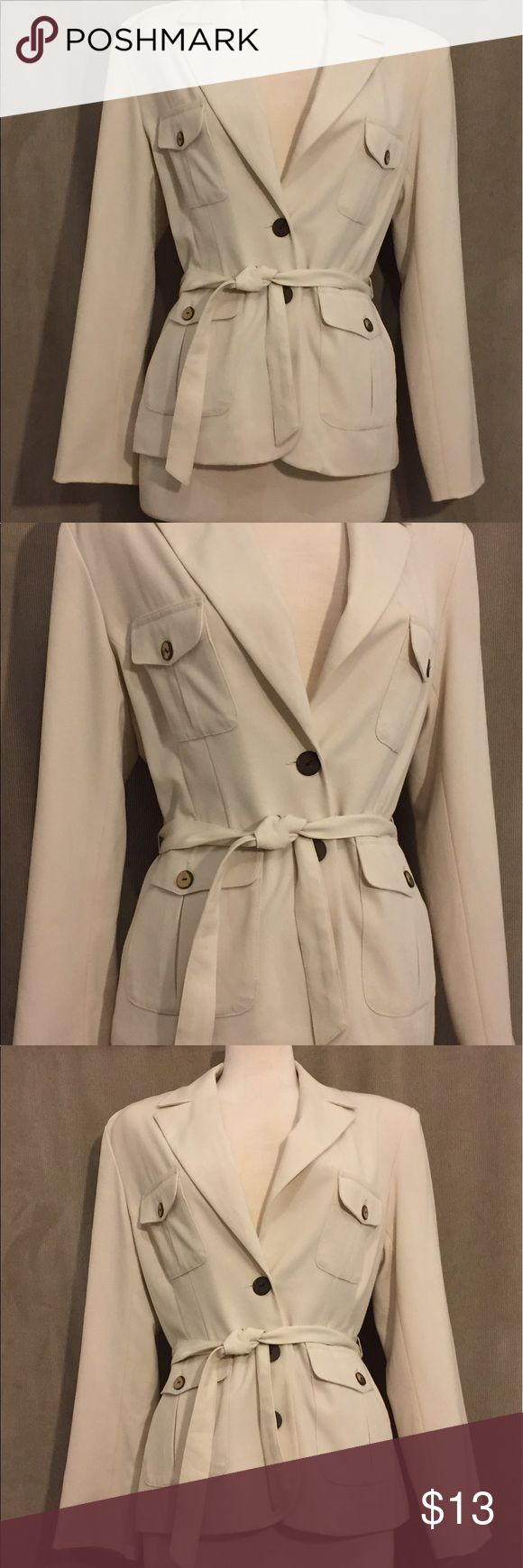 Safari style belted blazer Safari style belted blazer has a notched collar that is belted and features 4 working pockets with wood grain buttons. Christy Miller Jackets & Coats Blazers