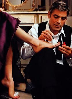 George Clooney giving a pedicure.