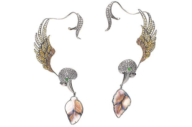 18-karat white gold ear cuffs with an ombre of diamonds from white to golden to grey to black, with tsavorite eyes and opal leaves. By Wendy Yue