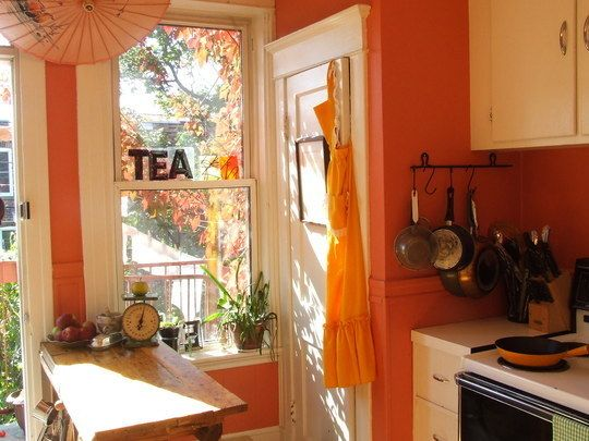 I love this kitchen. Coral walls!