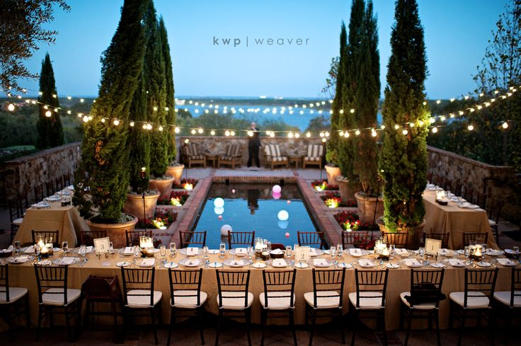 Swoon. Bella Collina near Orlando, FL. Not Tuscany. STUNNING. Banquet tables. Potted Cypress. String lights. Chiavari chairs. Twilight.