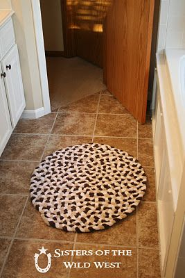Recycle towels into a rug - for the bathroom! This is the best friggin' idea! I MUST do this for the bathrooms!!! We need rugs and I can make them the shape/size I need them to be!!!! Probably for pennies on the dollar!!! WOO HOO!!!