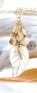 Gold and Cream Closinee Leaf Pendant with 22 Karat Gold plated leaves. 14 Karat Gold filled chain and Golden