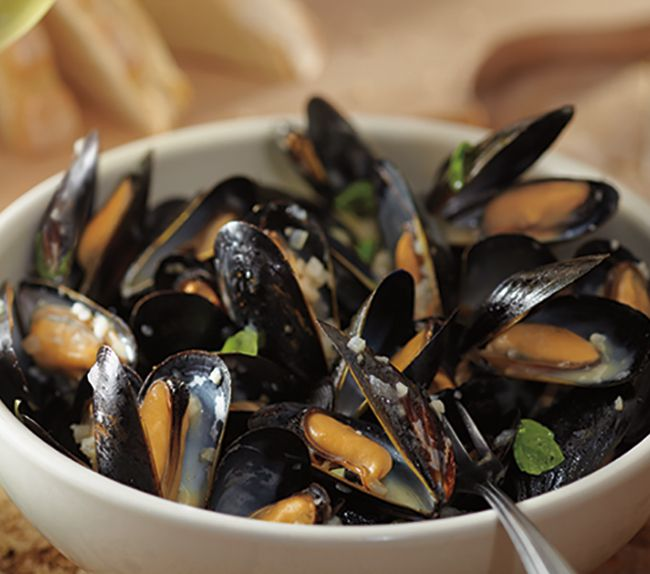 Carrabba's Housemade Signature Lemon Butter Sauce with fresh Basil over Prince Edward Island Mussels