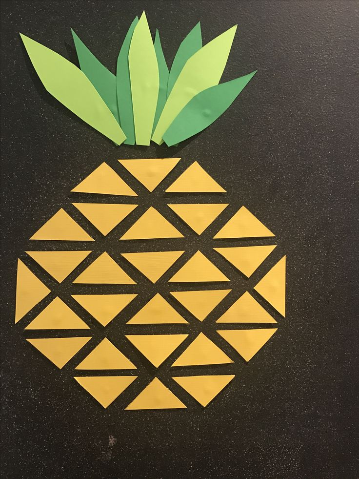 Simple deco made with colored paper triangles for a pineapple themed party