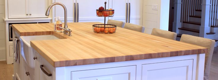 Hard rock maple butcher block island top with farmhouse sink