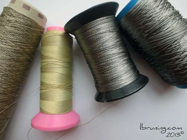 Conductive thread options - stainless steel thread and nylon threads coated with silver.  Use these threads to conduct electricity in eTextiles, soft-circuits, and craft-tech projects.  lynne bruning (february 2014)