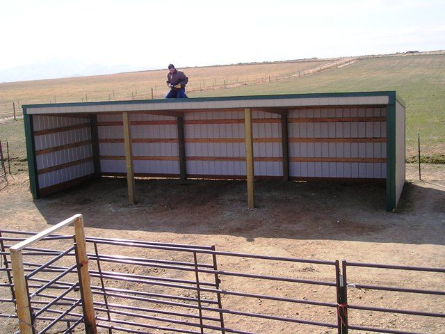 horse barns and stalls | horse shelter putting on finishing touches on horse shelter shop