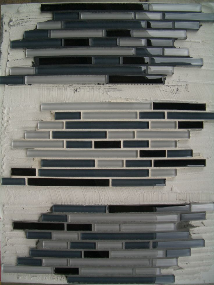 Glass backsplash in Fort Collins with light gray grout