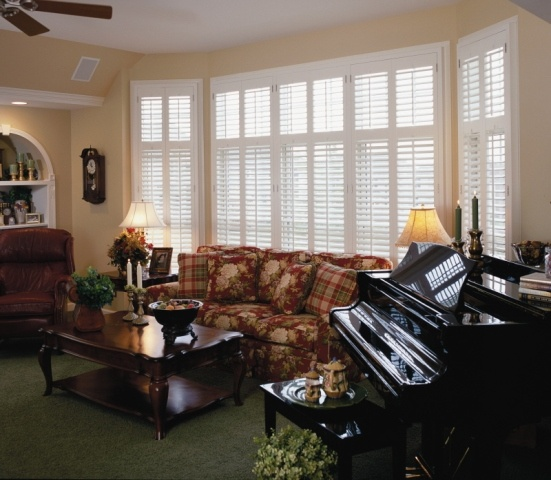 Great Room With Wall Of Windows, Covered With Custom Interior Wood Shutters.