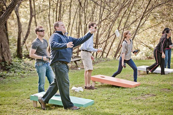 wedding lawn games Set up a bean bag toss, a DIY bowling alley, or picnic tables with board and card games.