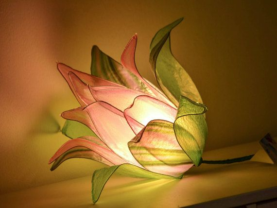 This lamp is a unique piece and is designed to create in your home a corner of tranquility and relaxation. The power of light and colors are enhanced by transparencies and veils of this exciting lamp. Each leaf of the flower bud is created by hand, the central rose leaves are painted with colors for glass, the outer leaves are photo processing designed by photographer Pier Balen. The lamp is designed to be easily used in any environment, mounted on a cable with Plug and switch can be placed…