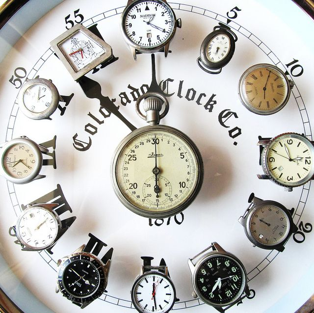 Old wrist watches into a wall clock with each watch set to the time of placement