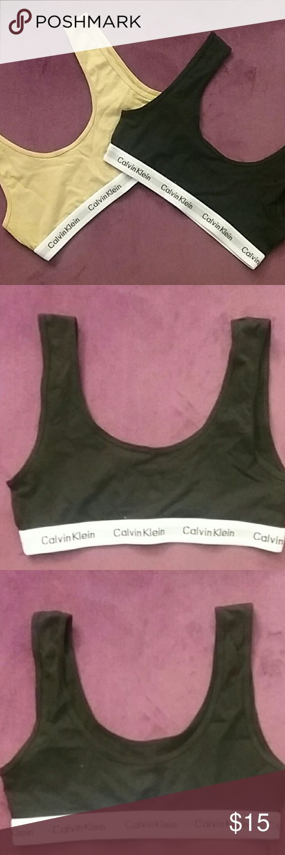 Calvin Klein Sports / Training Bra NWOT Two Calvin Klein training/sports bras. One black, one tan/nude. Willing to sell together or separately. Price listed is for both together. Bought these thinking they were for adults, but they're actually for little girls. Might fit an adult with a smaller bust though. Calvin Klein Other