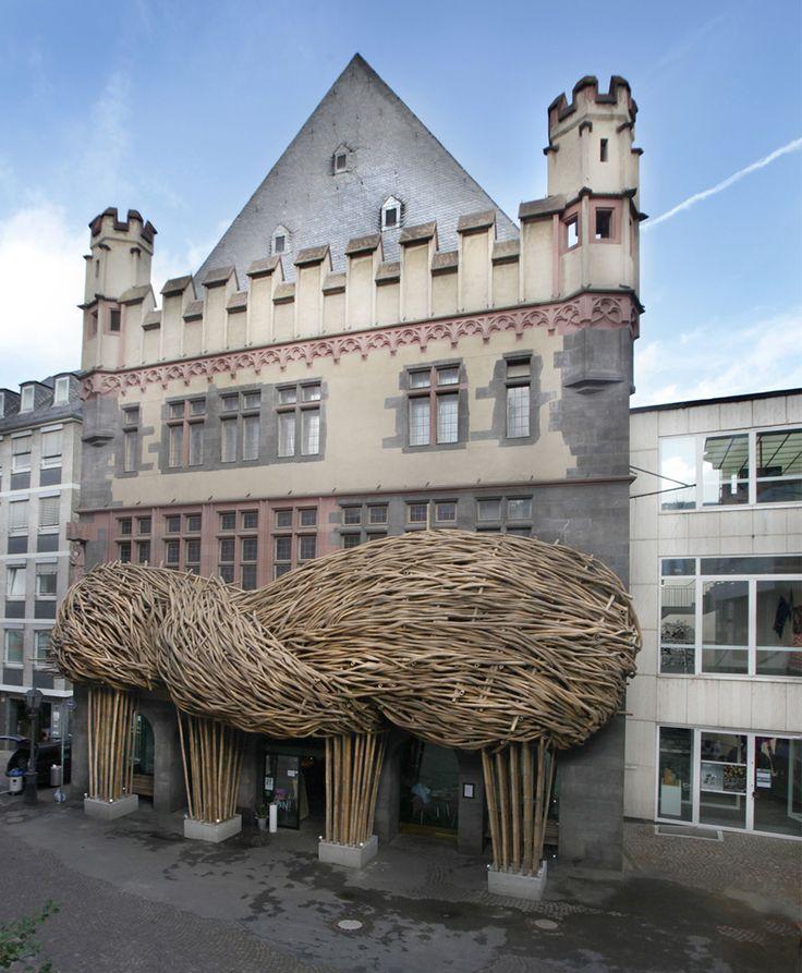 An organically-shaped bamboo facade installed at a German art museum