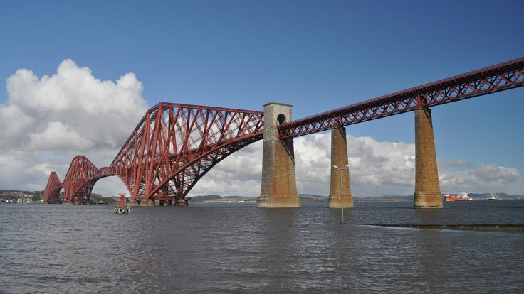 https://flic.kr/p/fGVVcm | Forth (Railway) Bridge, Scotland | The Forth Bridge, which spans the estuary (Firth) of the River Forth in eastern Scotland to link Fife to Edinburgh by railway, was the world's earliest great multispan cantilever bridge, and at 2,529 m remains one of the longest. It opened in 1890 and continues to operate as an important passenger and freight rail bridge. This enormous structure, with its distinctive industrial aesthetic and striking red colour, was conceived and…
