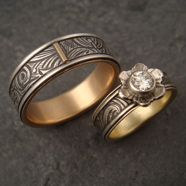 this was a custom wedding set that i made for a local couple his the wider one is sterling silver with a gold lining hers is white gold with an lining - Couples Wedding Rings