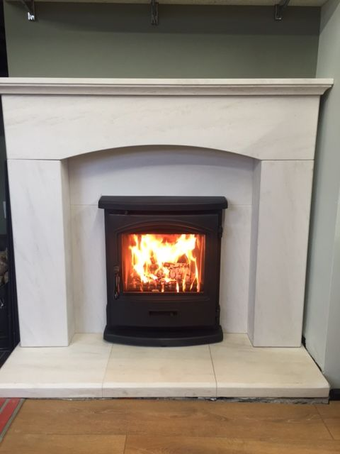 "The Sierra Inset Woodburning Stove set in the stunning Faro 48"" Suite in Portuguese Limestone both from Capital Fireplaces Ltd"