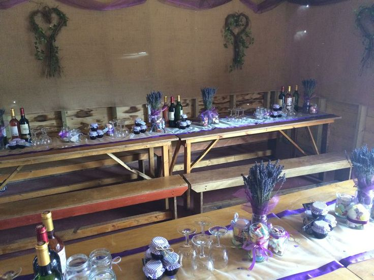 Rustic wedding table decorations. Lavender in old jars, home made jam and jars of sweets.