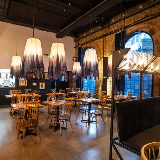 The bar itself is expansive, all New York warehousey – somewhat of a triumph, almost taking over an entire wall with vertically-mounted iron wine racks, shelves and chalkboard scribblings. The canteen style restaurant is spacious yet (too) dimly lit, and I like the little extras...