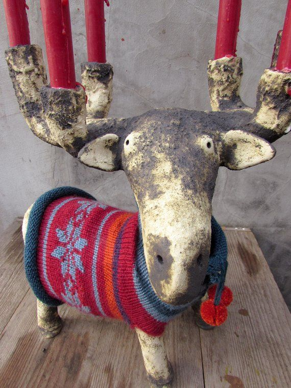 Ceramic Moose Candelabra in a hand knitted sweater with Norwegian star pattern and two pom poms in front