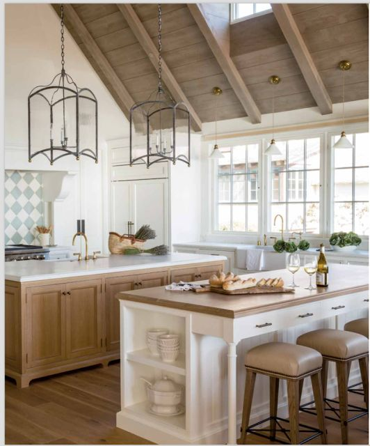 A breathtaking French inspired modern farmhouse kitchen with white oak, wood ceiling, two islands, and elegant beachy Giannetti patina style.