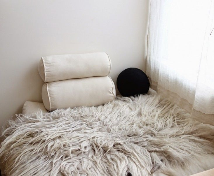 Momish Pillow | Remodelista  I canNOT get enough of sheepskin.  It adds so much warmth....sorry sheep.