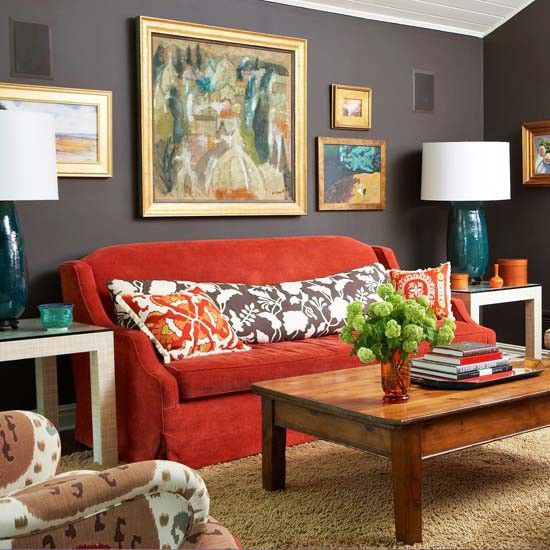 This Living Room With A Brick Red Couch And Cool Grey Walls With Gold  Accents And