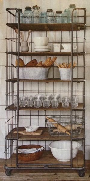 LOVE this metal and wood shelving unit which provides tons of storage and charm -- Interesting Shelving Ideas: Moss Blogs – Moss Cottage