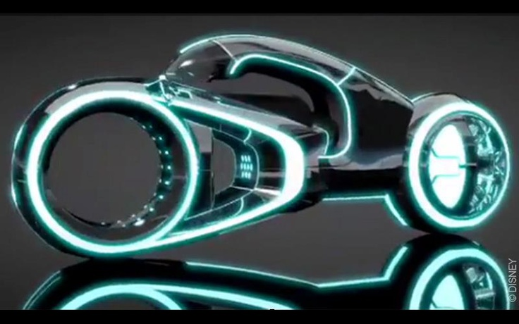 This vehicle concept art is based on the very popular films torn and tron legacy. The light cycle based on a motor bike was mainly on the game grid for program to compete and survive. The cycle has the same basic movements as a normal bike but the stream of light  that come from the back is used as a weapon to take out competitors. The way the bike is designed it is very science fictional