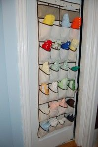 Over the door shoe...um, diaper holder--Whether you're short on space (like we were) or just want a place to easily access diapers, the shoe rack gives you a place to put them...And other baby items.