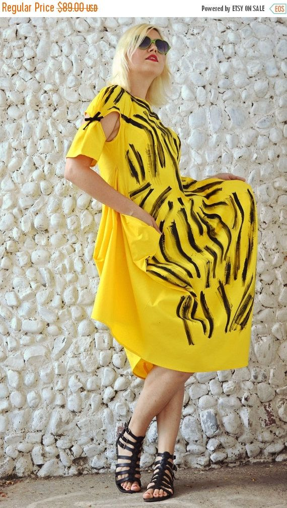 Yellow funky dress made of pure cotton with handmade painted design, very playful and comfortable. This extravagant dress is a unique piece that will brighten up the streets! Material: 95% Cotton, 5% Elastane Care instructions: Wash at 30 degrees  The model in the picture is size S.  Can be made in ALL SIZES.  If you have any other specific requirements, do not hesitate to contact me!  I DO NOT CHARGE EXTRA MONEY for custom made items.   All you need to do is send me your measurements…