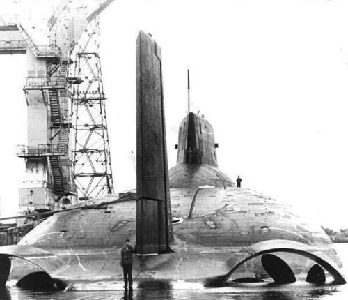 """Back view of a Project 941 or Akula, Russian """"Акула"""" (""""Shark"""") class submarine (NATO reporting name: Typhoon), a type of nuclear-powered ballistic missile submarine deployed by the Soviet Navy in the 1980s. The Typhoons are the largest class of submarine ever built. Photo: Russian Submarines Info: Wikipedia"""