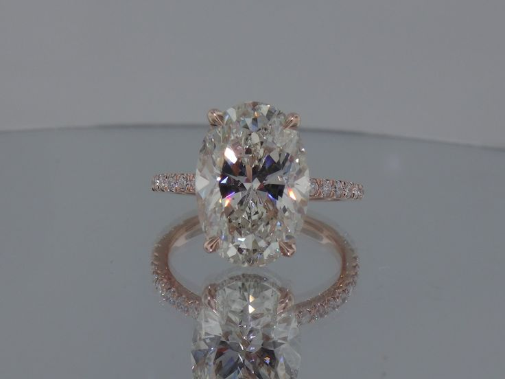 Another picture of the prettiest ring ever!! :) Josh Levkoff - Collection, Rings - Rose Gold Oval Custom Engagement Ring with MicroPave Diamonds | Josh Levkoff