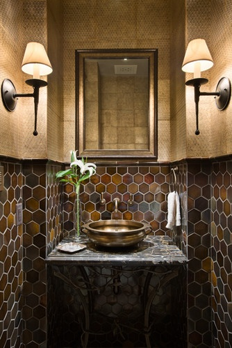 Love the gorgeous hex tile in this powder room!