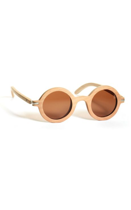 // Wooden sunglasses by Waiting for the Sun.