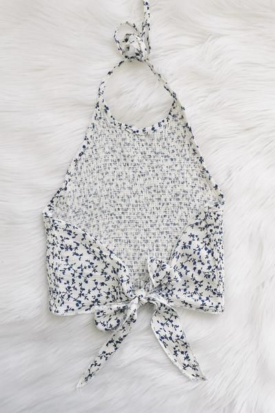 "- Details - Size - Shipping - • 100% Rayon • Self tie crop halter top. • Hand Wash • Line dry • Imported • Measured from small • Length 10"" • Chest 13"" • Waist 11.5"" - Free domestic shipping on U.S. o"